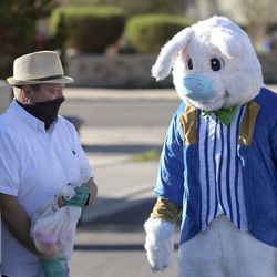 Draper Mayor Troy Walker, left, and the Easter Bunny deliver Easter eggs to children in Draper City on Friday, April 10, 2020. Due to the COVID-19 pandemic, the Draper City Parks and Recreation Department created the alternative event for children in order to provide holiday festivities while following Centers for Disease Control guidelines. Residents opted-in for the Easter egg delivery service, resulting in 30,000 eggs being delivered on more than 30 delivery routes to 1,045 households.