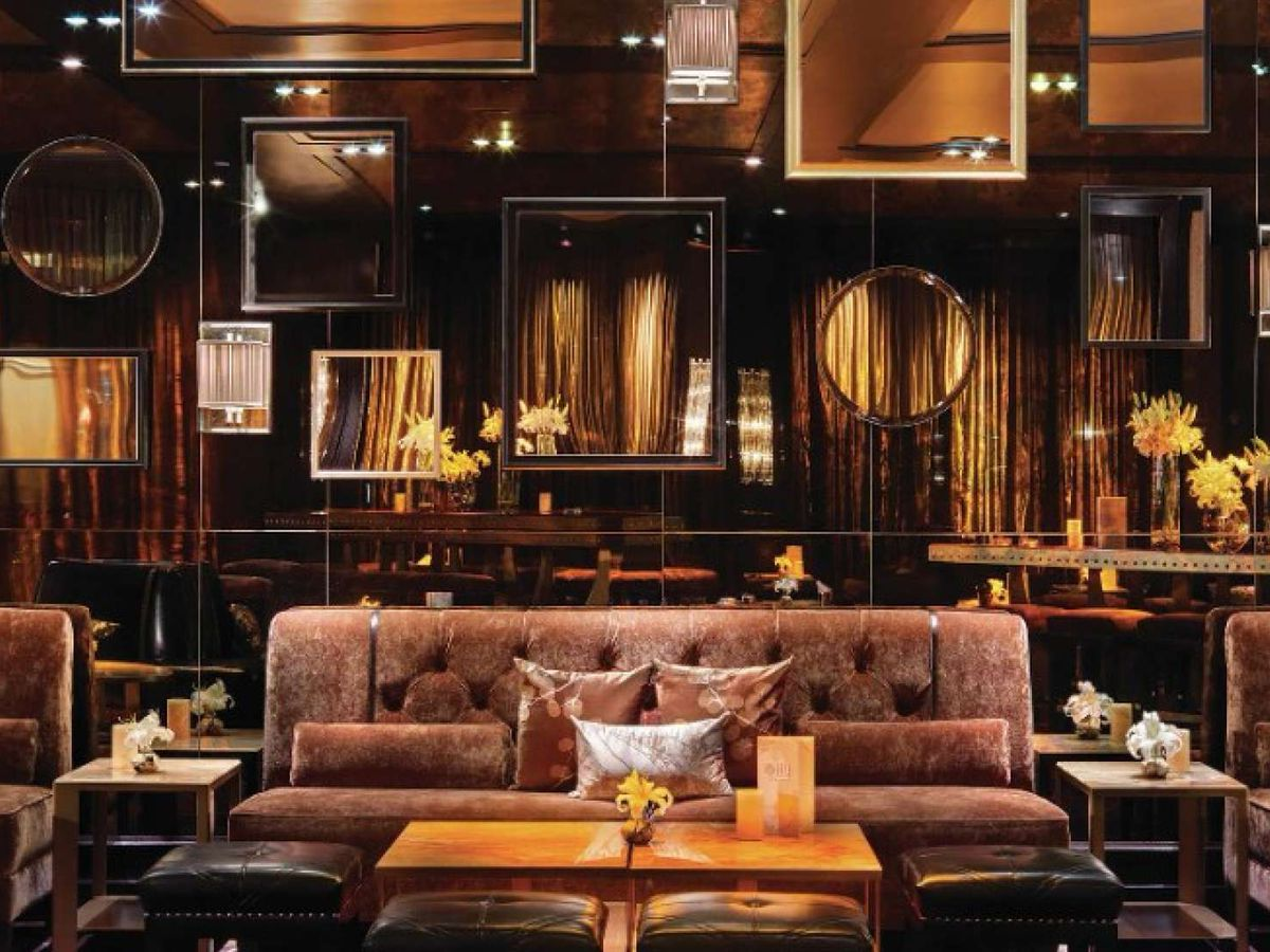 Velvet couches in a bar setting