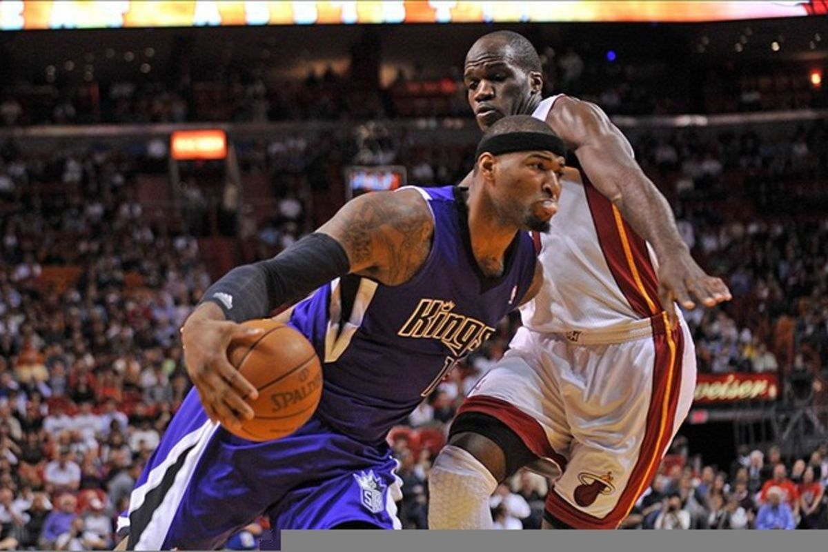 Feb. 21, 2012; Miami, FL, USA; Sacramento Kings power forward DeMarcus Cousins (15) drives past Miami Heat center Joel Anthony (50) during the first half at American Airlines Arena. Mandatory Credit: Steve Mitchell-US PRESSWIRE