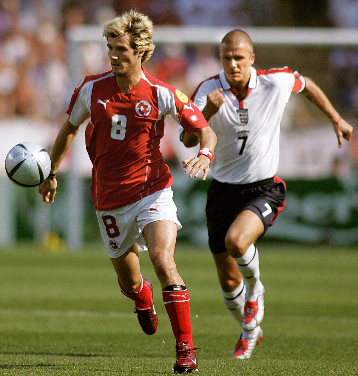 England's midfielder and captain David B