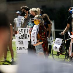 Protesters gather in Presidents Circle at the University of Utah in Salt Lake City on Thursday, Sept. 3, 2020. Responding to the university's handling of the case of slain student Lauren McCluskey, protesters called for the resignation of university president Ruth Watkins, the abolition of the university police department, and a redistribution of police funding into counseling and social services.