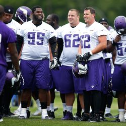 Jul 27, 2013; Mankato, MN, USA; Minnesota Vikings defensive tackle Sharrif Floyd (95) and defensive tackle Chase Baker (62) and linebacker Chad Greenway (52)  laugh after practice ended with a turnover by the defense at training camp at Blakeslee Fields.