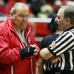 Jon Huntsman Sr. speaks with a referee during halftime in an NCAA men's college basketball game against the Southern Utah University Thunderbirds at the Jon M. Huntsman Center in Salt Lake City, Friday, Nov. 13, 2015.