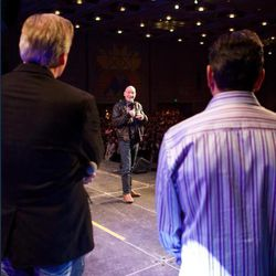 Sir Patrick Stewart turns to speak to Salt Lake Comic Con FanXperience co-founders Dan Farr and Bryan Brandenburg.