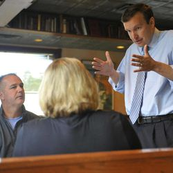In this Wednesday, Sept. 19, 2012 photo, Democratic candidate for U.S. Senate Chris Murphy, right, talks with Chris Sudock, left, and Laura Sudock, center at a diner in Meriden, Conn. Wealthy former pro wrestling executive Linda McMahon is shifting her image from groin-kicking CEO to grandmother in her second bid for a Senate seat from Connecticut. Polls show the strategy seems to be working against three-term Democratic congressman Murphy.