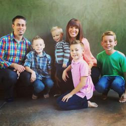 Brooke Romney, center, poses with her husband and four sons.