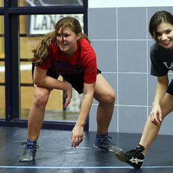 Kathleen Janis, center, works out with the Crusher Wrestling Club at Layton High School in Layton on Tuesday, March 1, 2016.