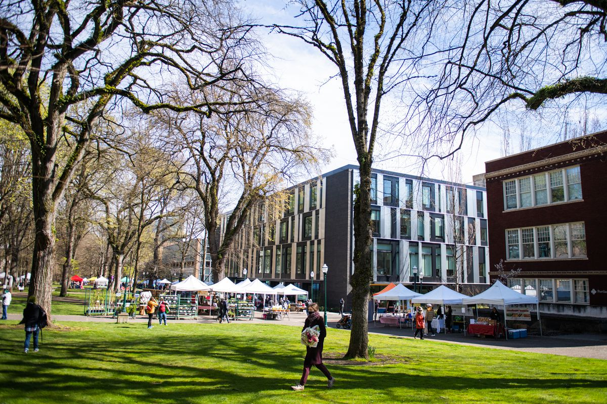 The Saturday market near Portland State University, weirdly empty with just around 10 tents. Only two or three people walk around the grounds.