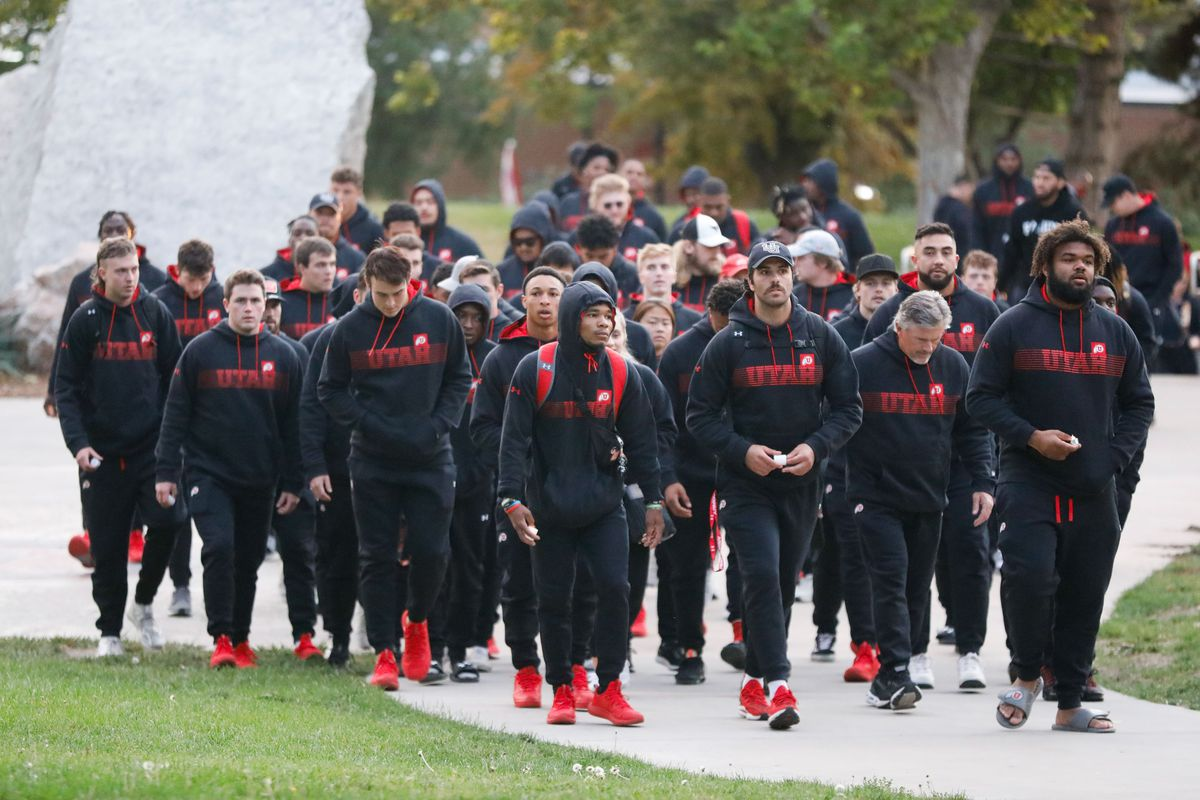 University of Utah football players arrive to a candlelight vigil remembering the life of slain student-athlete Aaron Lowe.