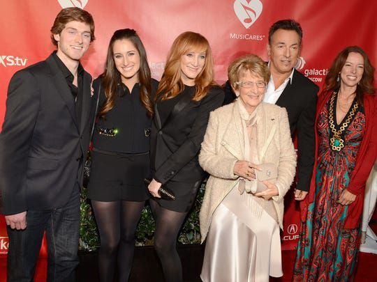 """This 2013 photo shows an unidentified man with Jessica Rae Springsteen, Patti Scialfa, Adele Springsteen, Bruce Springsteen and Pamela Springsteen at MusiCares """"Person of the Year"""" ceremony honoring Bruce Springsteen."""