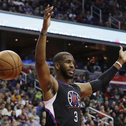 FILE - In this Dec. 28, 2015, file photo, Los Angeles Clippers guard Chris Paul reacts after dunking the ball during the first half of an NBA basketball game against the Washington Wizards, in Washington. The Houston Rockets have reached an agreement to trade for Los Angeles Clippers point guard Chris Paul according to a person familiar with the deal. The league source spoke to The Associated Press on Wednesday, June 28, 2017,  on the condition of anonymity because the team hasn't finalized the trade.