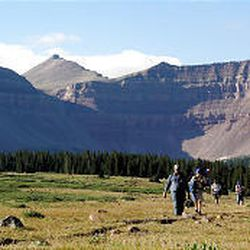 A Boy Scout troop from West Jordan and a church group from Bountiful walk away from Kings Peak, shown at the upper left. Kings Peak is the tallest mountain in Utah.