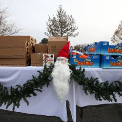 Oranges and yogurts sit on a table with a Santa Claus decoration during the Big Brothers Big Sisters Holiday Drive Thru at a parking lot in Taylorsville on Thursday, Dec. 10, 2020.During the event, Littles (youths living in adversity), their Bigs (volunteer mentors) and their families were invited to pick up warm winter coats, gift cards and fun treats.