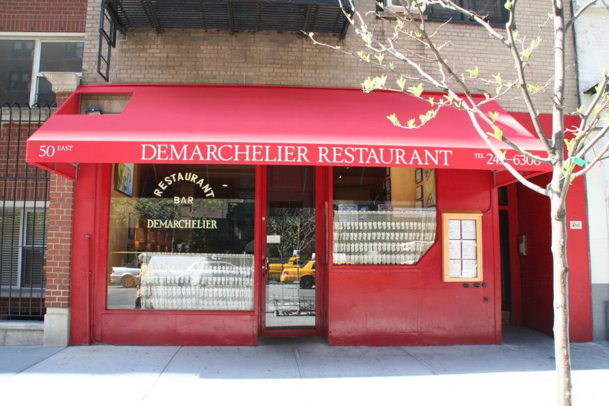 The red awning and front entrance of the french bistro Demarchelier on the Upper East Side.