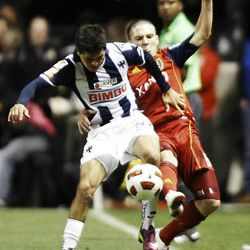 Will Johnson (behind) of Real Salt Lake fights for control of the ball against Sergio Perez from the Rayados of Monterrey during the final game of the CONCACAF championship at Rio Tinto Stadium in Sandy Wednesday, April 27, 2011.