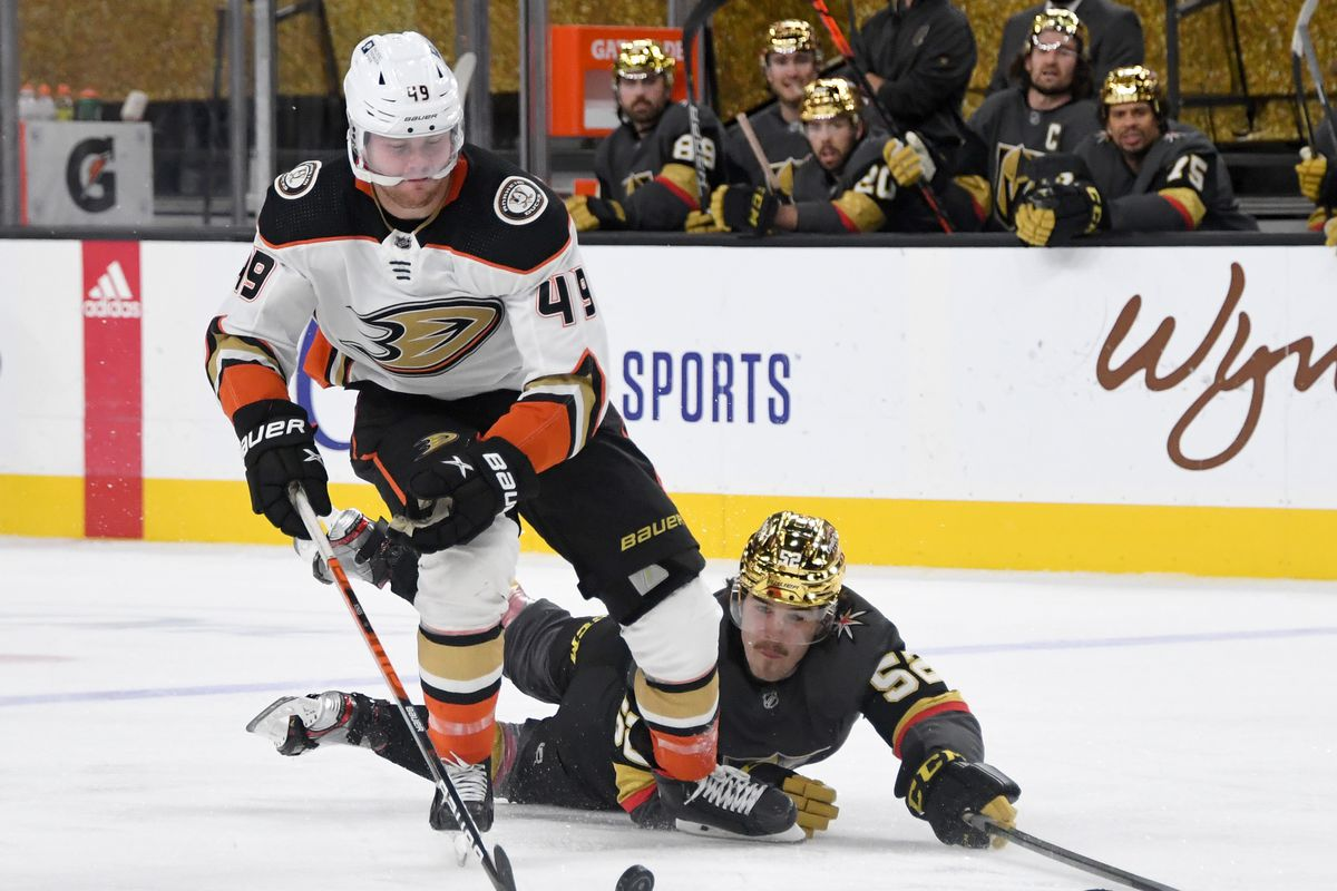 Dylan Coghlan #52 of the Vegas Golden Knights stops a breakaway by Max Jones #49 of the Anaheim Ducks in the third period of their game at T-Mobile Arena on February 11, 2021 in Las Vegas, Nevada. The Ducks defeated the Golden Knights 1-0.