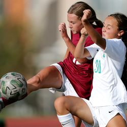 Viewmont's Brynn Rees kicks the ball away from Ellie Marriott as Farmington and Viewmont girls battle to a 1-1 tie at the end of regulation playin Bountiful on Tuesday, Sept. 22, 2020. Farmington went on to advance with a 3-1 win in penalty kicks.