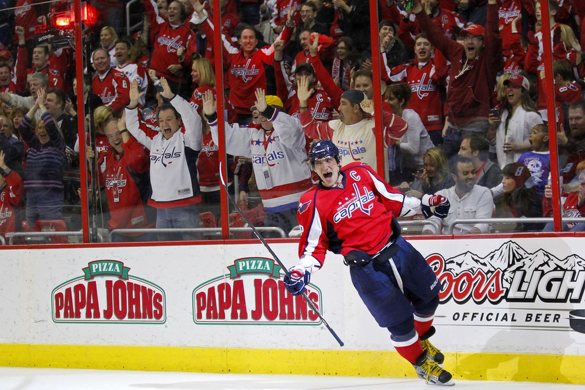 March 25, 2012; Washington, DC, USA; Washington Capitals left wing Alex Ovechkin (8) celebrates after scoring a goal against the Minnesota Wild in the third period at Verizon Center. The Capitals won 3-0. Mandatory Credit: Geoff Burke-US PRESSWIRE