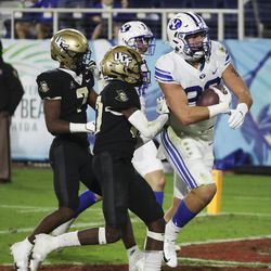 Brigham Young Cougars tight end Isaac Rex (83) catches touchdown against the UCF Knights during the Boca Raton Bowl in Boca Raton, Fla., on Tuesday, Dec. 22, 2020.