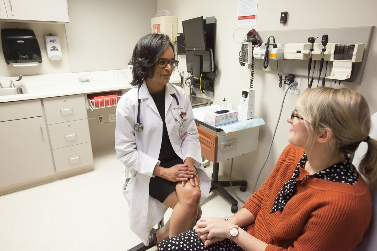 Monica Christmas, M.D., meets with a patient at the Duchossois Center for Advanced Medicine at the University of Chicago.
