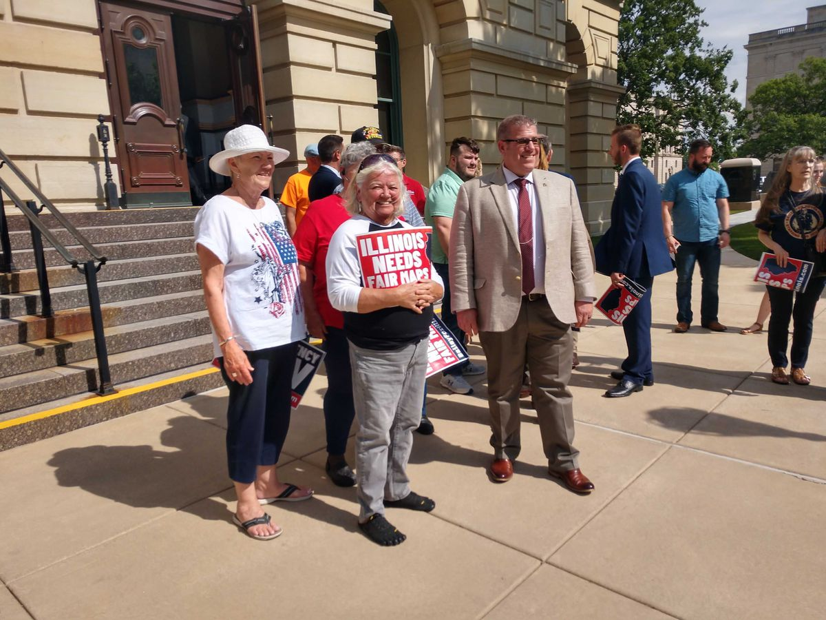 State Sen. Darren Bailey, R-Xenia, fourth from right, stands with supporters at this news conference at the State Capitol on Tuesday.