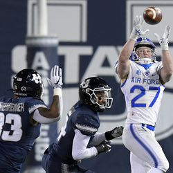 Air Force wide receiver Ben Peterson (27) catches a pass as Utah State linebacker Kevin Meitzenheimer (33) and safety Shaq Bond defend during the second half of an NCAA college football game Thursday, Dec. 3, 2020, in Logan, Utah.