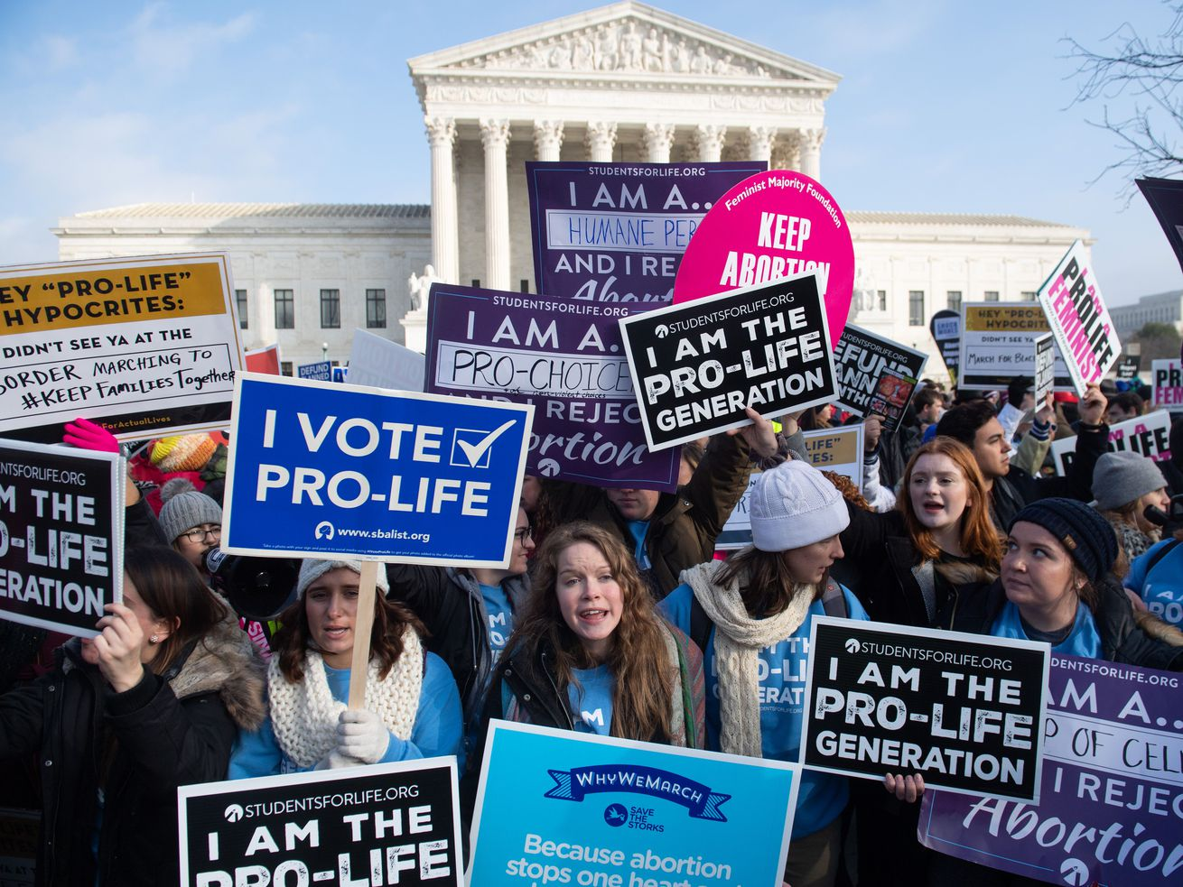Activists on both sides of the abortion issue protest outside outside the US Supreme Court in Washington, DC, on January 18, 2019.