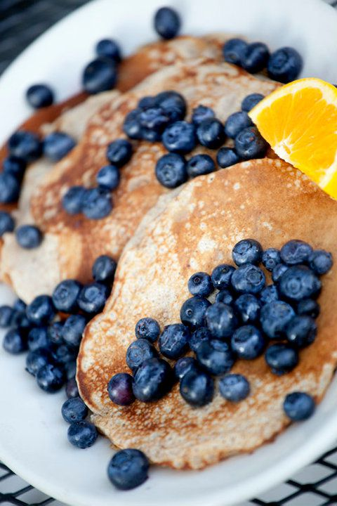 Closeup of pancakes topped with fresh blueberries