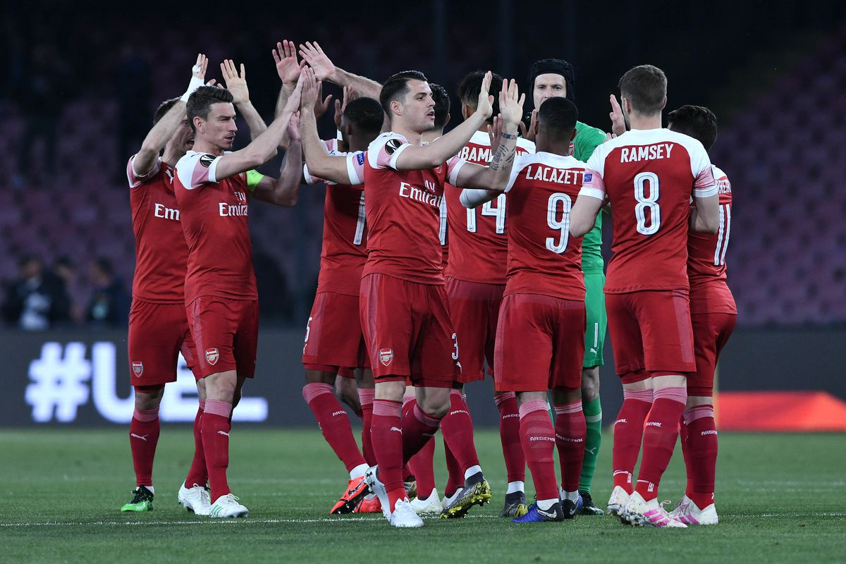 Arsenal's players celebrate at the end of the UEFA Europa...