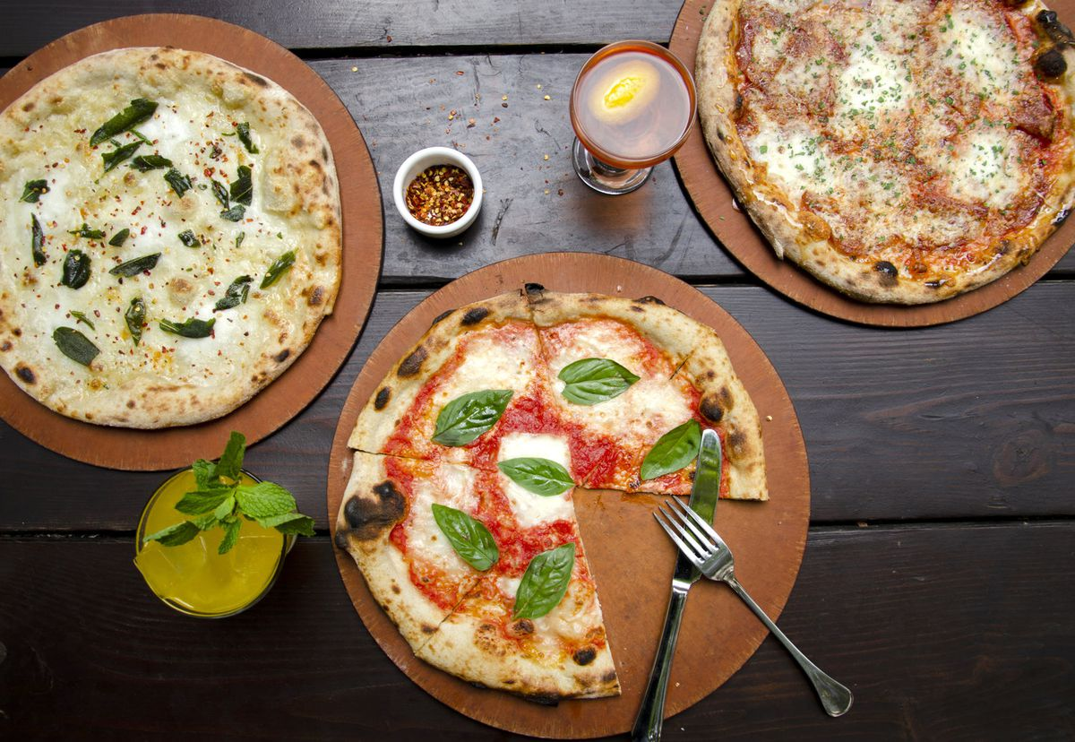An overhead picture of Oven & Shaker pizzas, including a margherita