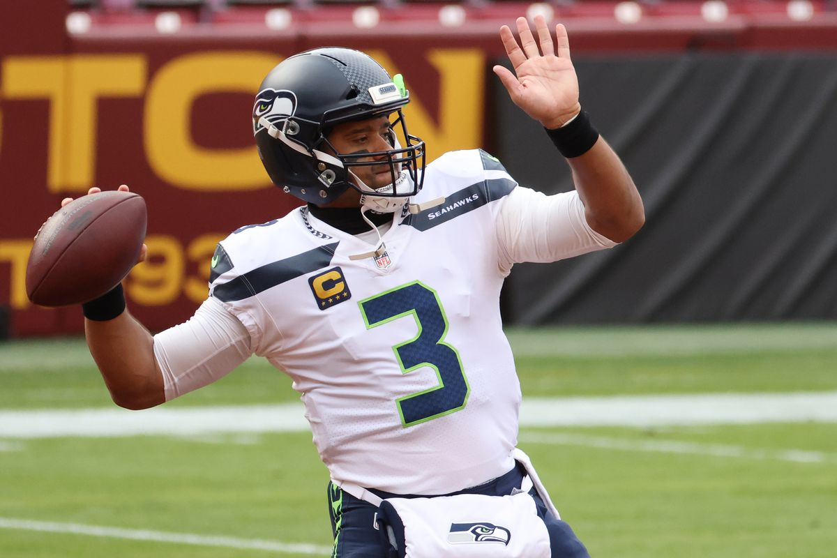Seattle Seahawks quarterback Russell Wilson (3) passes the ball during warm ups prior to the Seahawks' game against the Washington Football Team at FedExField.