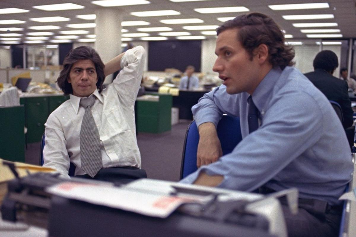 Reporters Bob Woodward, right, and Carl Bernstein, whose reporting of the Watergate case won them a Pulitzer Prize, sit in the newsroom of the Washington Post May 7, 1973.