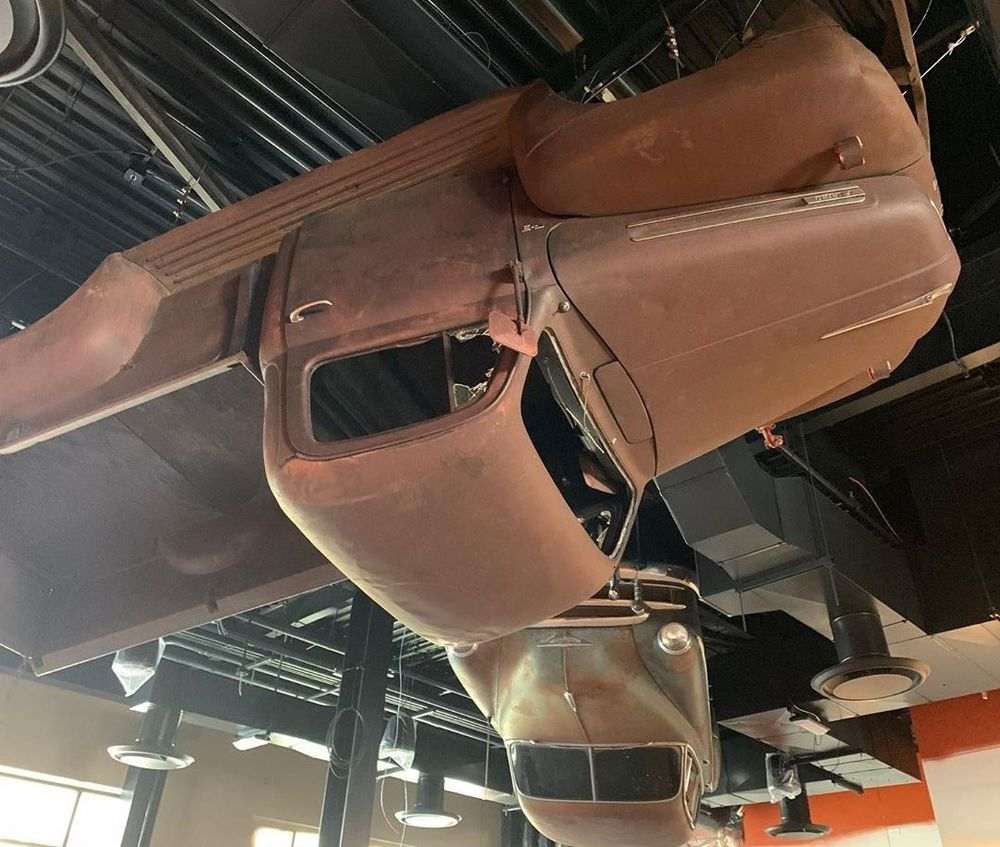 Two vehicles mounted to the ceiling at the retro-themed Sickies Garage Burgers & Brews coming to Towns Square this fall.