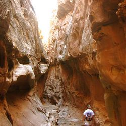14. A hiker heads back after hiking through Crack Canyon.