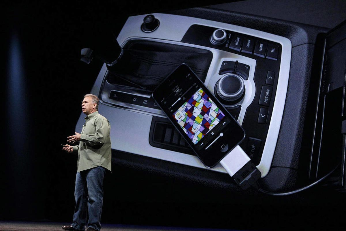 Phil Schiller, Apple's senior vice president of worldwide marketing, speaks on stage about new connectivity features during an introduction of the new iPhone 5 in San Francisco, Wednesday Sept. 12, 2012.