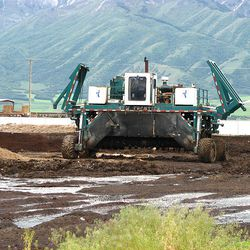 Compost-turning equipment recycles byproducts of other companies at Miller LC.