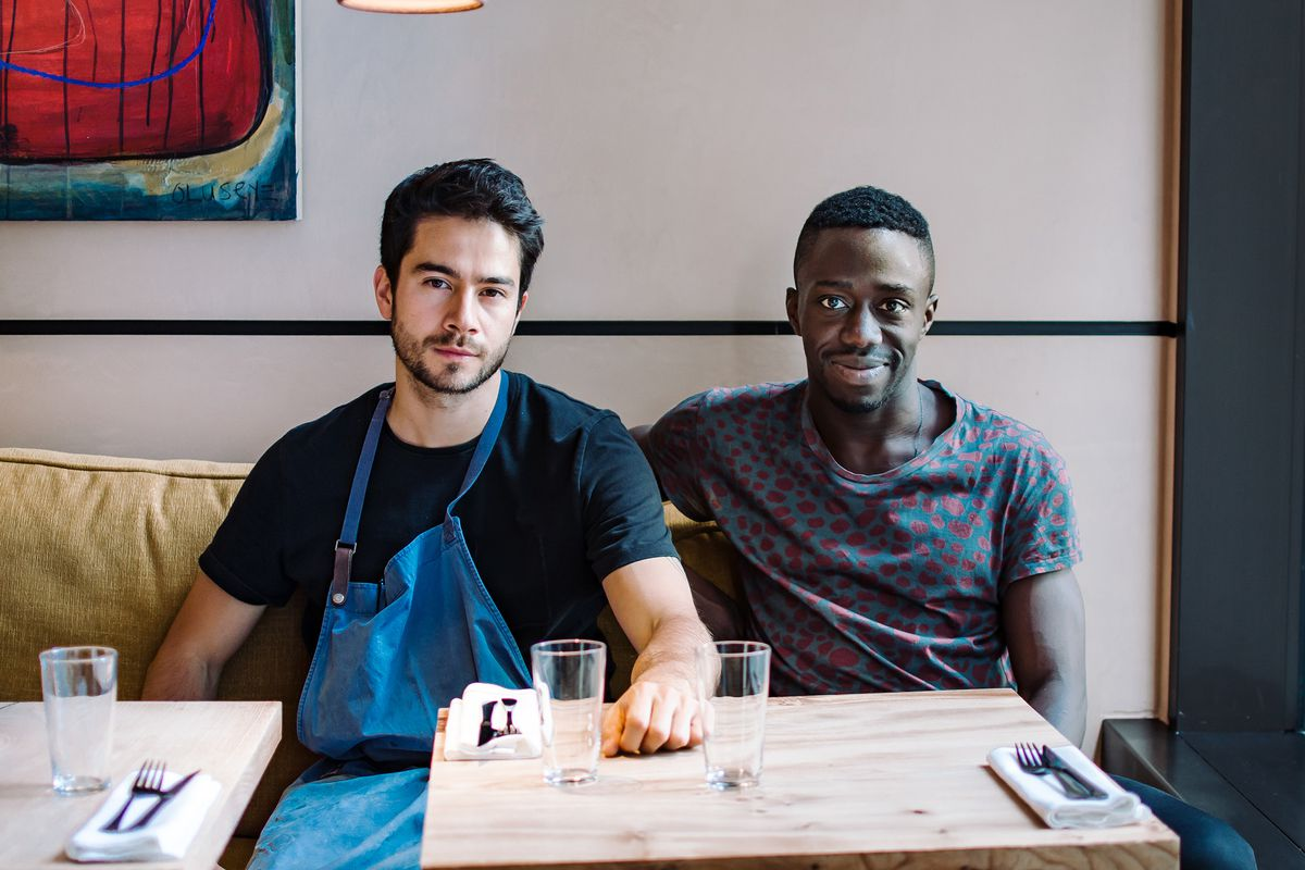 Chef Jeremy Chan and owner Iré Hassan-Odukale sit inside their Michelin-starred restaurant, Ikoyi, in London