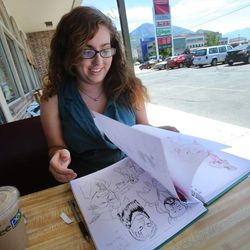 Taylor Holt works on her drawings while spending time at the Coffee Pod on Friday, Aug. 2, 2013. Holt applied this summer to be accepted into the BYU animation program. It was her second and final chance.