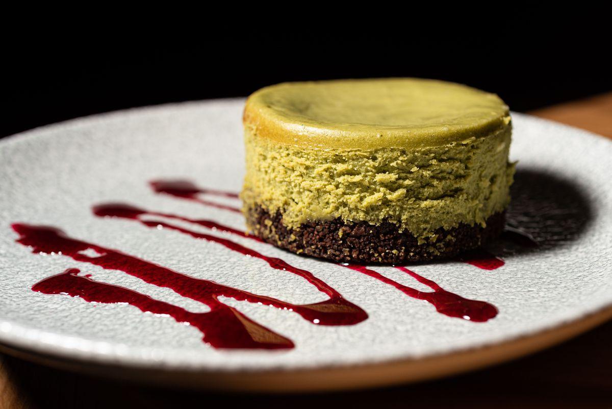 A light green matcha Basque style cheesecake.