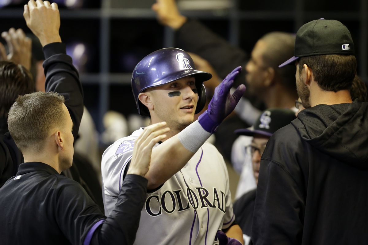 Troy Tulowitzki celebrates in the dugout after hitting his second home run of the season in the Rockies 8-4 win over Milwaukee.