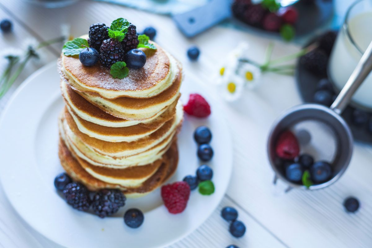 Delicious homemade pancakes with berries and milk