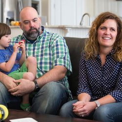 Trey and Heidi Wallis, with their son, Louie, talk about why they are fighting to have GAMT screening placed on the national newborn screening list during an interview in their Bluffdale home on Wednesday, Nov. 2, 2016. Louie and his sister, Sam, have the rare disease guanidinoacetate methyltransferase (GAMT) deficiency.