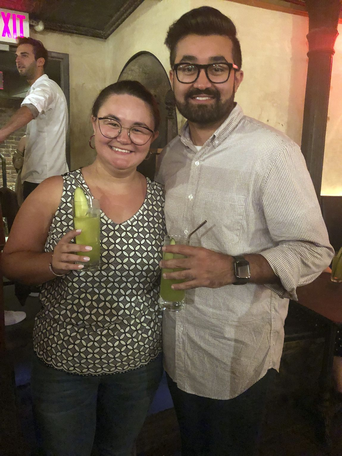 Cat Tjan, 27, of Jersey City, N.J., left, and Ammar Farooqi, 26, from Williamstown, N.J. posing their mocktail dubbed Me, A Houseplant, a green concoction comprised of Seedlip's Garden 108 variety (the one with the peas), cucumber, lemon and elderflower a