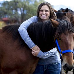 Jaylee Rasmussen is pictured with her mustang, Montana, near her home in West Haven, Weber County, on Wednesday, Oct. 2, 2019. The Bureau of Land Management and Utah 4-H have partnered for the Youth and Military Mustang Trail Challenge where youth and veterans choose a wild mustang and have approximately 100 days to turn it into a gentle, adoptable equine companion. Because no one made a bid on Montana, Rasmussen bought her for $25, which was the minimum bid.