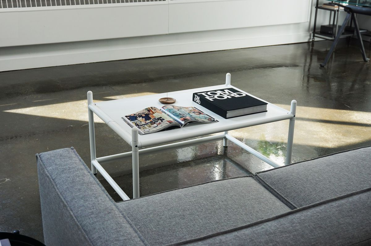 Coffee table next to couch