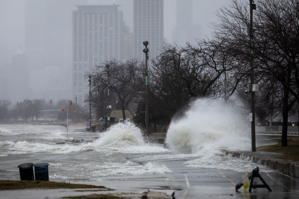 A lakeshore flood warning was issued March 6, 2020, as high winds are expected to kick up waves up to 13 feet near the Lake Michigan shoreline. In this Sun-Times file photo, high waves from Lake Michigan hit the lakefront trail near Fullerton Avenue Jan. 11, 2020.
