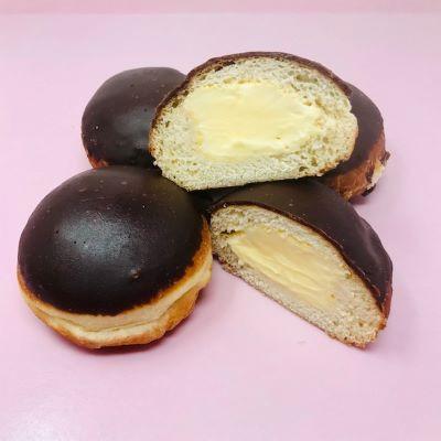 Chocolate-dipped paczki filled with vanilla cream