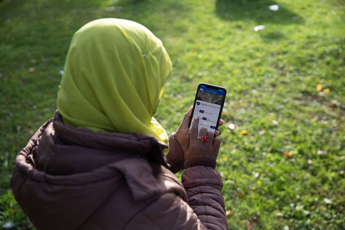 Woman using app in park
