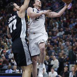 Utah Jazz forward Joe Ingles (2)  drives by San Antonio Spurs center Joffrey Lauvergne (77) in Salt Lake City on Thursday, Dec. 21, 2017.