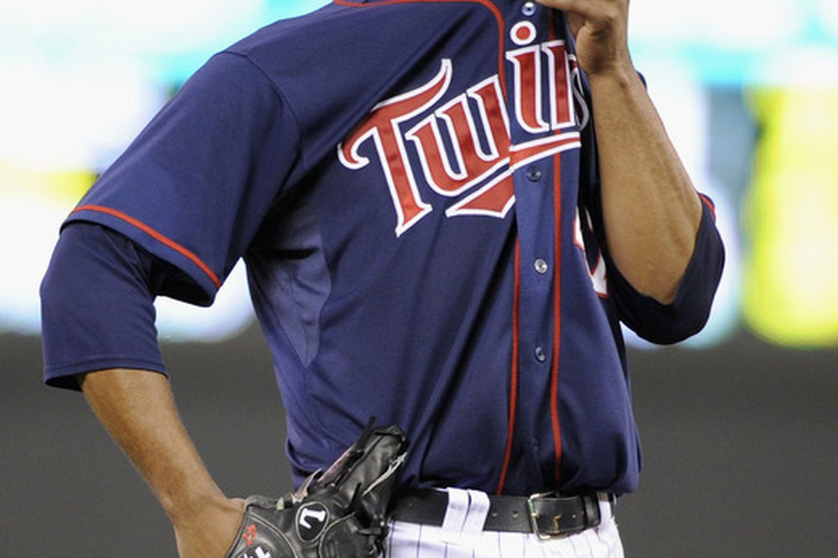 MINNEAPOLIS, MN - JUNE 15:  Francisco Liriano #47 of the Minnesota Twins reacts during the sixth inning against the Milwaukee Brewers on June 15, 2012 at Target Field in Minneapolis, Minnesota. (Photo by Hannah Foslien/Getty Images)
